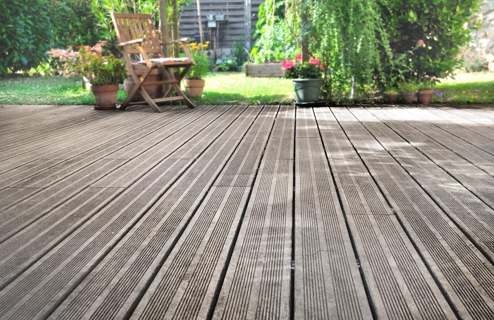 Wooden decking with chair and garden in background