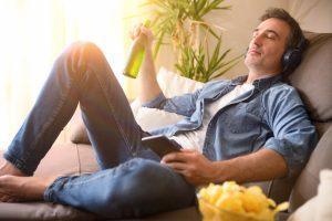 Man relaxing with beer in garden room